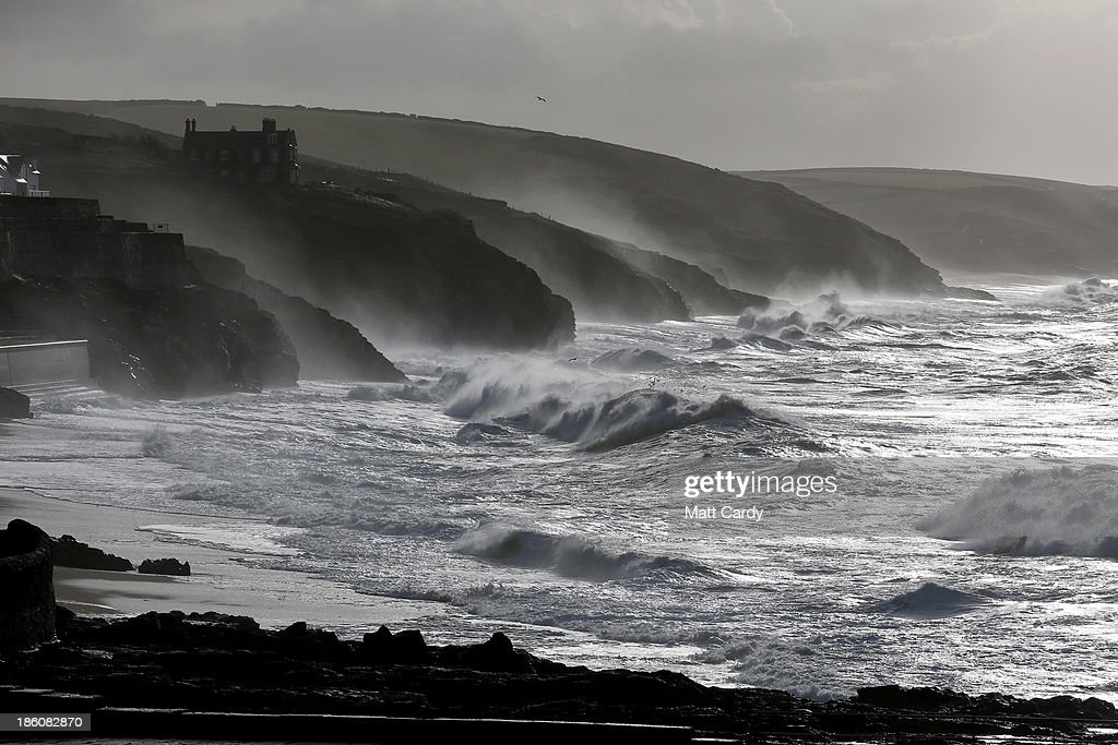 Large waves, produced by storm force winds break along the coast at Porthleven on October 28, 2013 in Cornwall, England. Approximately 220,000 homes are without power and two deaths have been recorded after much of southern England has been affected by a severe storm. Transport links on road, rail, air and sea have been severely disrupted by hurricane-force winds that have almost reached 100 mph in places.