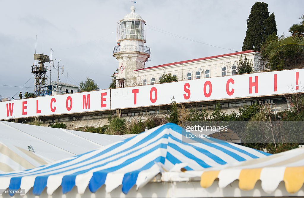 A large 'Welcome to Sochi!' sign hangs above the waterfront area in central Sochi, Russia, on February 18, 2013. With a year to go until the Sochi 2014 Winter Games, construction work and development continues as Olympic tests events and World Championship competitions are underway.
