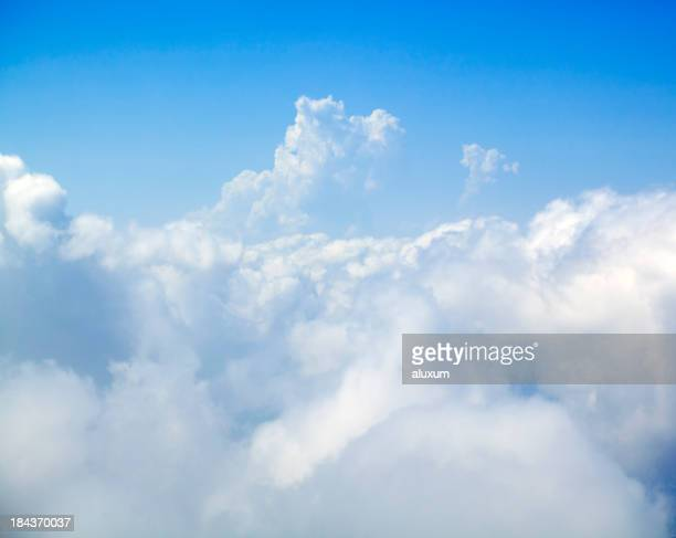 Large white fluffy clouds set against a bright blue sky