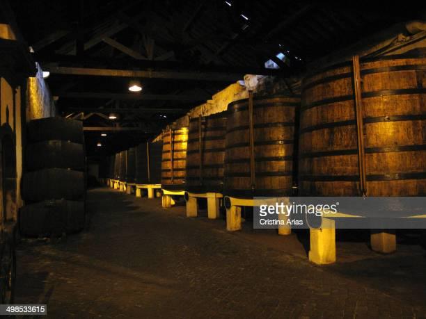 Large wooden barrels inside the Ferreria warehouses where port wine is kept in optimal conditions for processing Vila Nova de Gaia Porto Portugal...