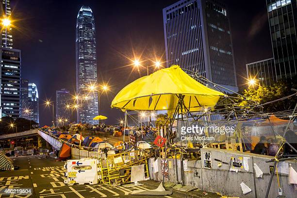 A large yellow umbrella created by prodemocracy activists is seen on the road outside Hong Kong's Government Complex on December 9 2014 in Hong Kong...