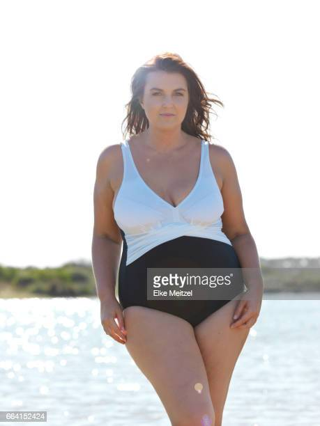 Larger statuesque woman by the beach