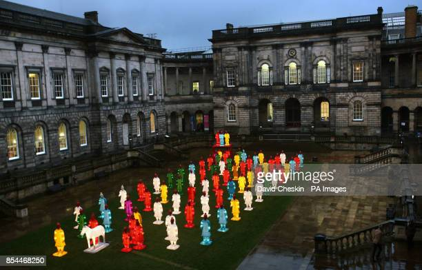 Larger than life lanterns inspired by the Terracotta Warriors created by artist Xia Nan for the Beijing Olympics are lit up at Edinburgh university...