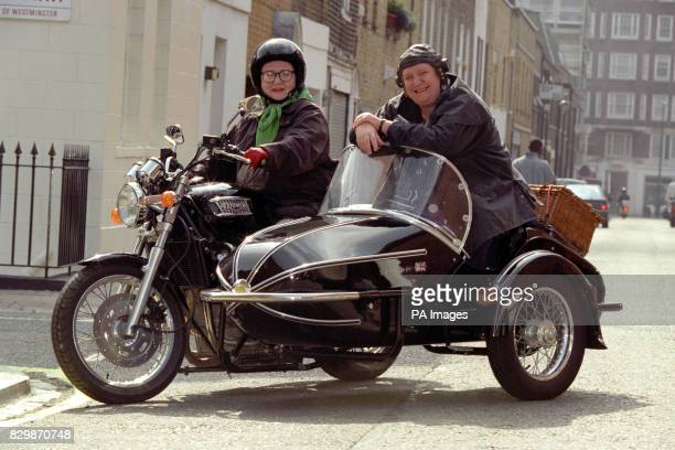 Largerthanlife cooks Jennifer Paterson and Clarissa Dickson Wright climb aboard their classic Triumph Thunderbird motorcycle and Watsonian sidecar...