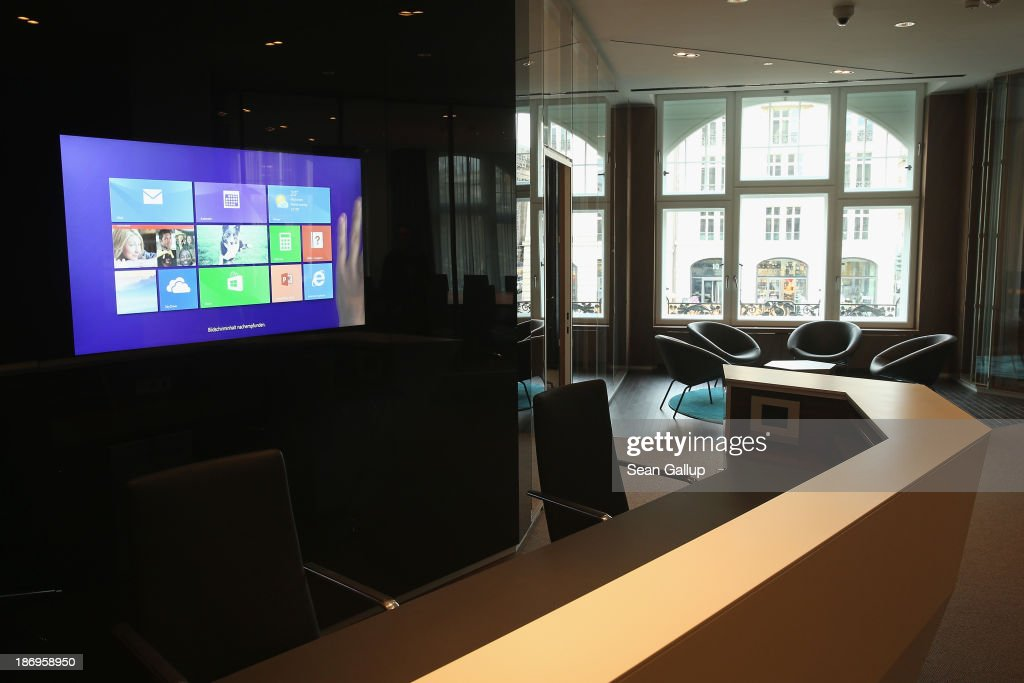A largescreen monitor shows the Windows 8 operating system in the new Microsoft Berlin center on November 5 2013 in Berlin Germany The Microsoft...