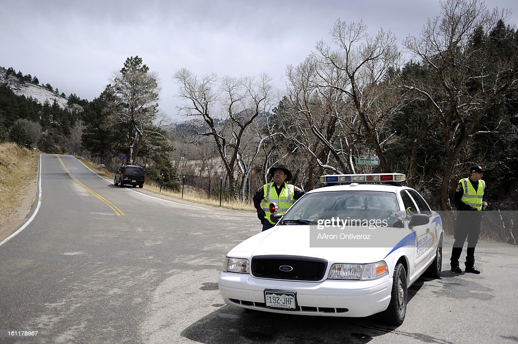 Larimer County Sheriff's deputies Archie Rodriguez (left) and Steve Nichols control a road block in Buckhorn Canyon during the Crystal Mountain fire on Sunday, April 3, 2011. Nichols said residents were evacuated late late Saturday night when the fire grew from some 20 acres to more than 2,000 within a few hours. AAron Ontiveroz, The Denver Post