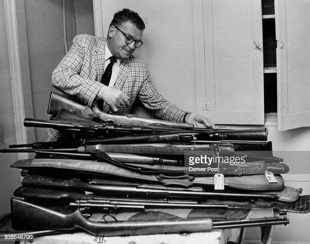JUN 18 1968 Larimer St loat office Sunday Detective WR Russell right checks rifles of headquarters They were found hidden beneath mattresses and in a...