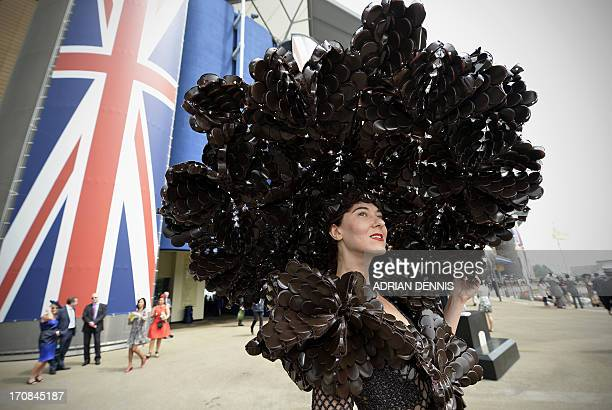 Larisa Katz wearing an outfit made from chocolate packaging poses for a photograph during the second day of Royal Ascot in Berkshire west of London...