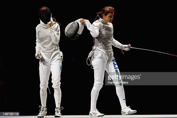 Larisa Korobeynikova of Russia and Arianna Errigo of Italy react during the Women's Foil Team Fencing gold medal match on Day 6 of the London 2012...