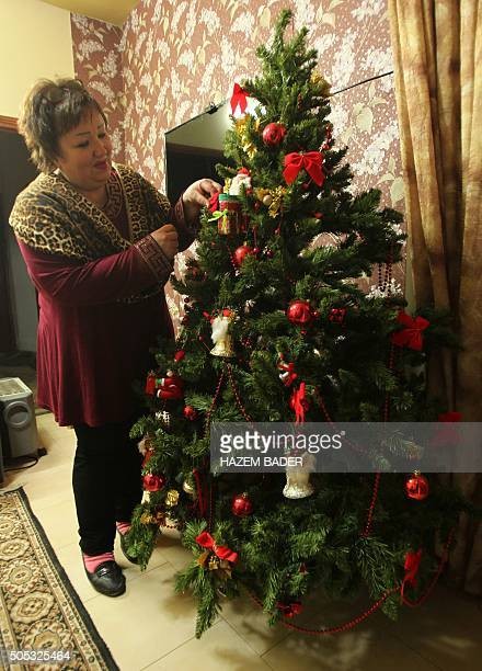 Larisa Loukianova a Russian Orthodox woman who married a Palestinian Muslim and moved to the West Bank city of Hebron 25 years ago decorates her...