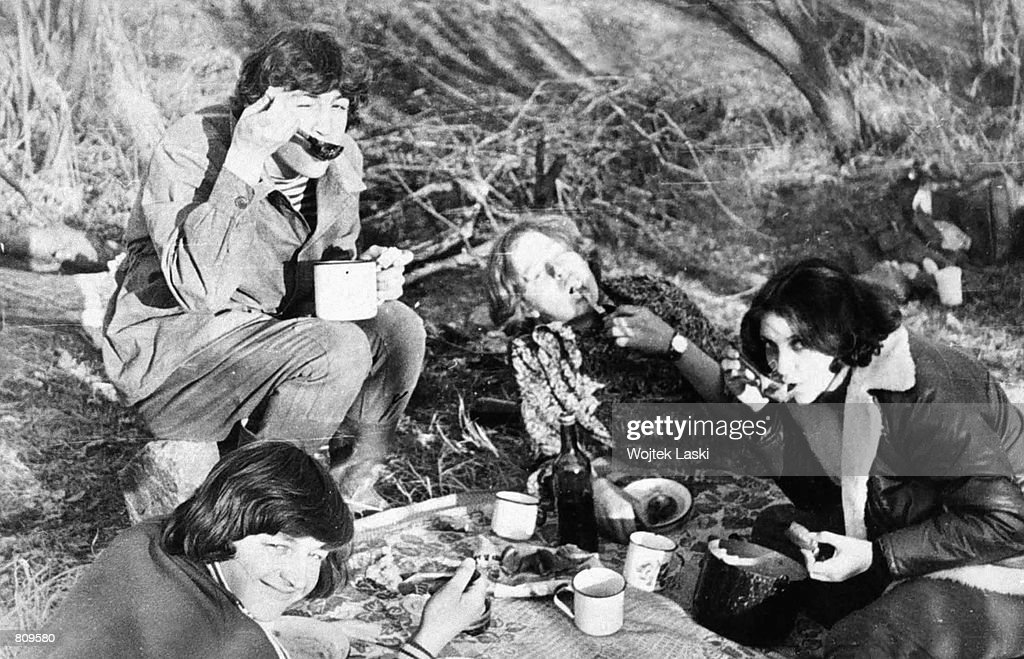 Larisa Savitskaya, right, the sole survivor of a 1981 mid-air plane collision which killed 26 people on the two aircraft, has a picnic in the forest with her husband Vladimir, top left, and friends in this photo from before the airplane crash. Savitskaya spoke publicly about the crash for the first time January 11, 2001 in Moscow, Russia. Savitskaya and her husband were returning from their honeymoon on August 24, 1981 when their Aeroflot AN-24 plane was ripped apart in a collision with a Soviet Tu-16k heavy bomber and plunged 5220 meters to earth. Savitskaya was found by a group of amazed rescuers three days later. Savitskaya, who eventually resumed her job as a sales manager, was warned by the KGB not to talk in public about her ordeal. Paid just $20 (75 Soviet Rubles in 1981) compensation by Aeroflot, the state airline, and now too poor even to afford the painkillers on which she relies, Savitskaya is planning on writing a book about the accident.