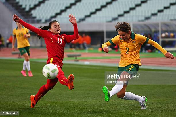 Larissa Crummer of Australia and Hoang Thi Loan of Vietnam compete for the ball during the AFC Women's Olympic Final Qualification Round match...