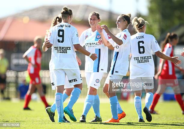 Larissa Crummer of City celebrates with her teammates after scoring the first goal during the round five WLeague match between Melbourne Cty FC and...