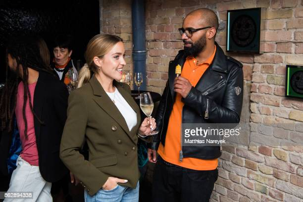 Larissa Laudenberger and Cedric Marlow during Romulo's 'Farbenspiel' exhibition opening at Hotel Provocateur on October 18 2017 in Berlin Germany