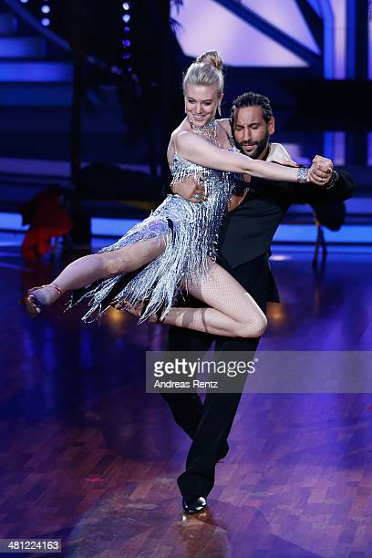 Larissa Marolt and Massimo Sinato perform on stage during the 1st Show of 'Let's Dance' on RTL at Coloneum on March 28 2014 in Cologne Germany