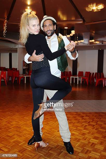 Larissa Marolt and Massimo Sinato pose at a photo call for the television competition 'Let's Dance' on March 20 2014 in Cologne Germany On March 28th...