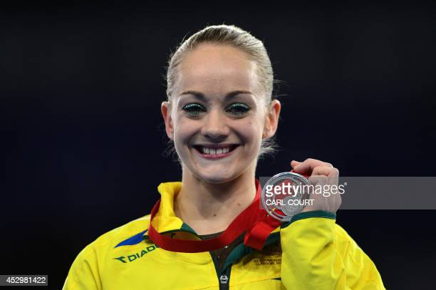 Larissa Miller of Australia poses with her medal after winning silver in the Women's Uneven Bars final of the Artistic Gymnastics event during the...