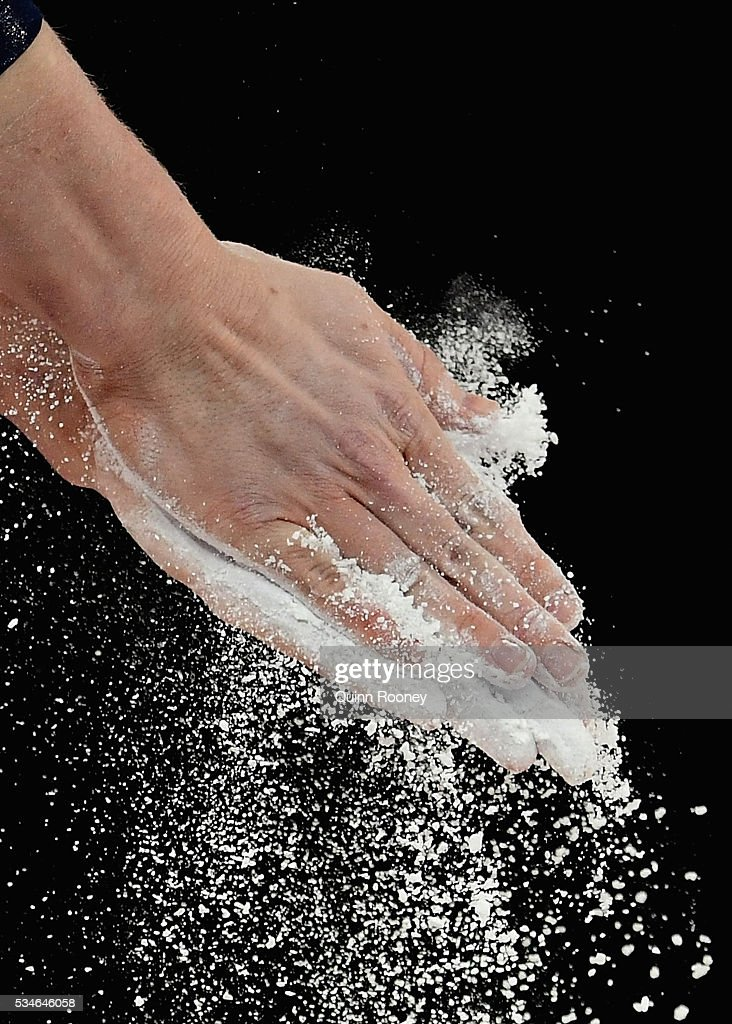 Larissa Miller of Victoria chalks her hands before competing on the floor during the 2016 Australian Gymnastics Championships at Hisense Arena on May 27, 2016 in Melbourne, Australia.