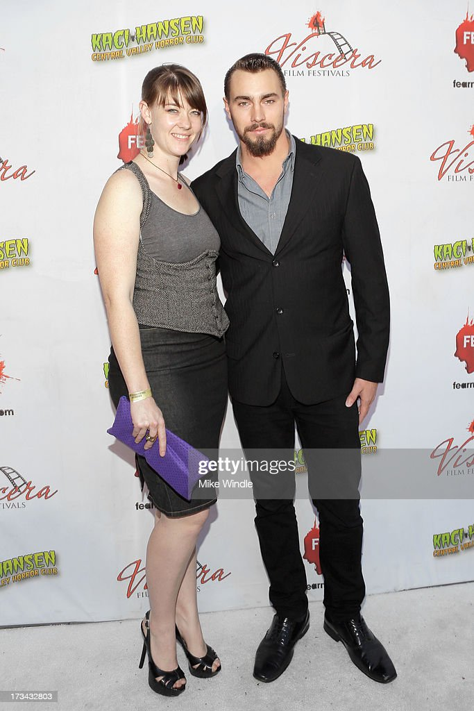 Lark Arrowood (L) and Brad Coffey arrive at the 2013 Viscera Film Festival Red Carpet Event at American Cinematheque's Egyptian Theatre on July 13, 2013 in Hollywood, California.