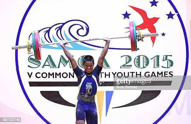 Larko Doguape of Nauru lifts during the Men 56kg A Weightlifting at the Tuanaimato Sports Facility on day one of the Samoa 2015 Commonwealth Youth...
