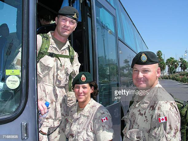 Canadian soldiers board a bus on their way to the airport to leave Cyprus 14 August 2006 in Larnaca About 1700 Canadian soldiers are passing through...