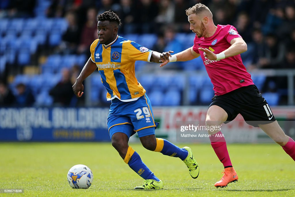 Larnell Cole of Shrewsbury Town and Marcus Maddison of Peterborough Unitedduring the Sky Bet Football League One match between Shrewsbury Town and Peterborough United at Greenhous Meadow Meadow on April 30, 2016 in Shrewsbury, England.