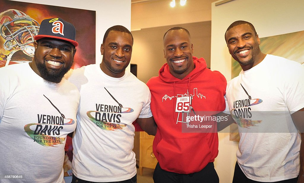 Larnell Ransom, Bob Johnson, <a gi-track='captionPersonalityLinkClicked' href=/galleries/search?phrase=Vernon+Davis&family=editorial&specificpeople=592553 ng-click='$event.stopPropagation()'>Vernon Davis</a> and Patrick Powell attends The <a gi-track='captionPersonalityLinkClicked' href=/galleries/search?phrase=Vernon+Davis&family=editorial&specificpeople=592553 ng-click='$event.stopPropagation()'>Vernon Davis</a> Foundation For The Arts Christmas Toy Give Away at <a gi-track='captionPersonalityLinkClicked' href=/galleries/search?phrase=Vernon+Davis&family=editorial&specificpeople=592553 ng-click='$event.stopPropagation()'>Vernon Davis</a> Art Gallery on December 21, 2013 in San Jose, California.