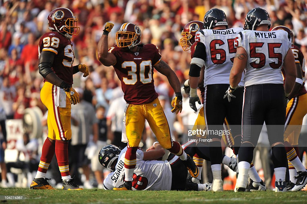<a gi-track='captionPersonalityLinkClicked' href=/galleries/search?phrase=LaRon+Landry&family=editorial&specificpeople=2109764 ng-click='$event.stopPropagation()'>LaRon Landry</a> #30 of the Washington Redskins celebrates a sack of <a gi-track='captionPersonalityLinkClicked' href=/galleries/search?phrase=Matt+Schaub&family=editorial&specificpeople=2210847 ng-click='$event.stopPropagation()'>Matt Schaub</a> #8 of the Houston Texans at FedExField on September 19, 2010 in Landover, Maryland. The Redskins lead the Texans at the half 20-7.