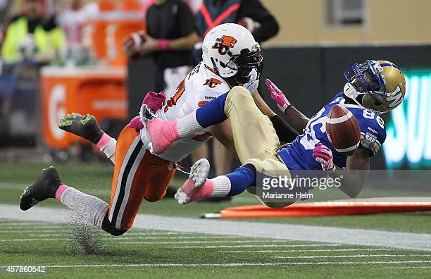R LaRose of the BC Lions knocks down intended receiver Justin Wilson of the Winnipeg Blue Bombers in first half action in a CFL game at Investors...