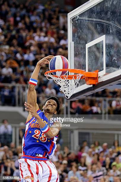 Larriques 'Beast' Cunningham of Harlem Globetrotters dunks the ball during the exhibition game between Harlem Globetrotters and World AllStars at...
