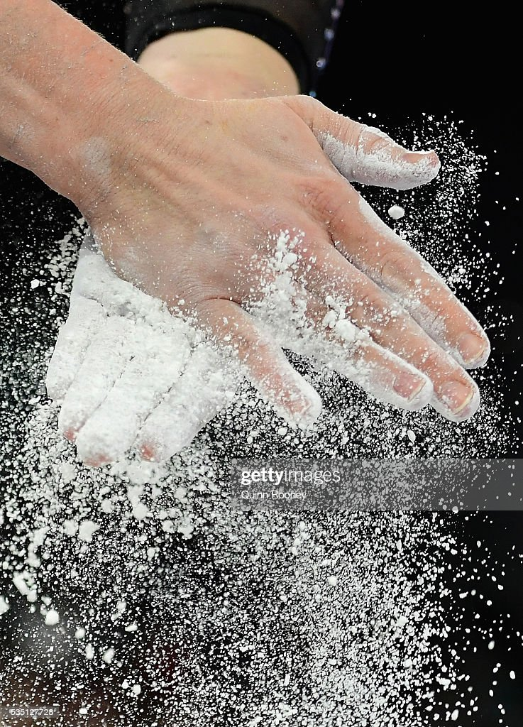Larissa Miller of Victoria chalks her hands before competing on the floor during the 2016 Australian Gymnastics Championships at Hisense Arena on May 29, 2016 in Melbourne, Australia.