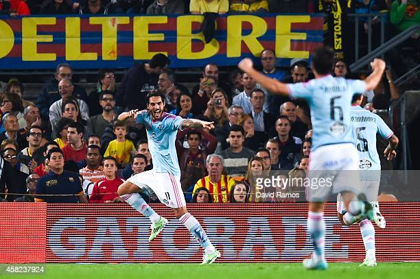 Larrivey of Celta de Vigo celebrates after scoring the opening goal during the La Liga match between FC Barcelona and Celta de Vigo at Camp Nou on...