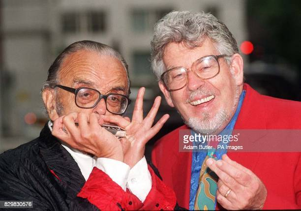 Larry Adler octogenarian harmonica player and Rolf Harris Painter songwriter and performer in London today to receive their British Academy of...