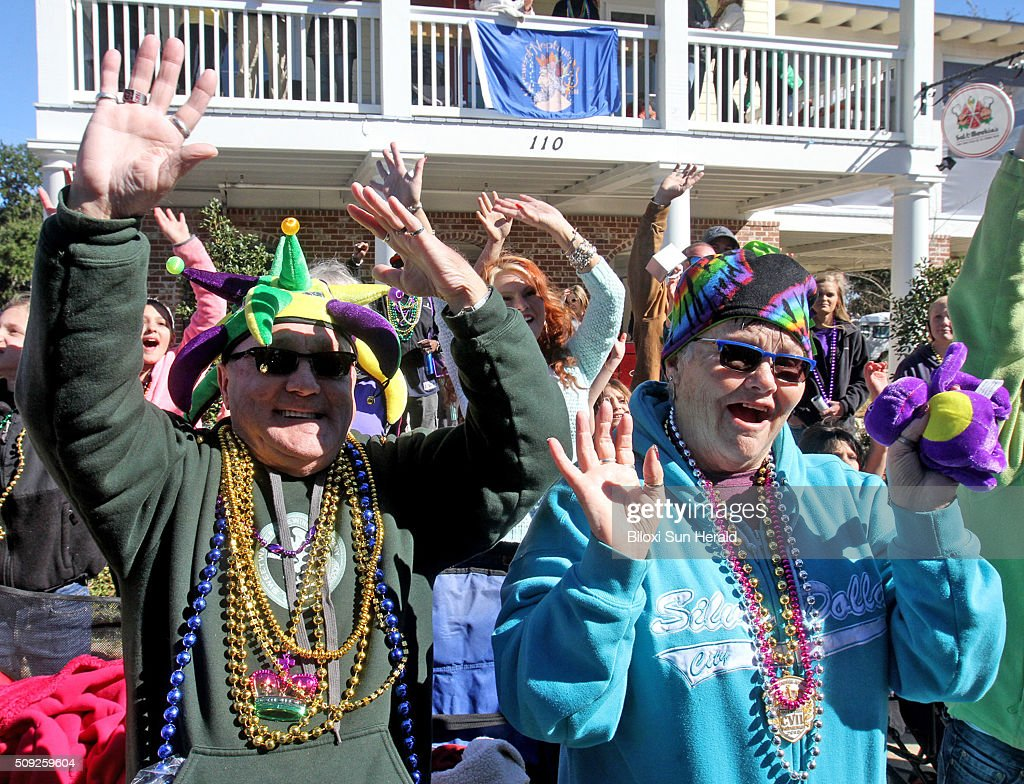 Larry and Shirley Davis of Creston, Iowa, call for throws during the Gulf Coast Carnival Association Mardi Gras Parade in Biloxi, Miss., on Tuesday, Feb. 9, 2016. Three parades rolled in South Mississippi on Fat Tuesday, the last day of carnival season, celebrated before the beginning of Lent.
