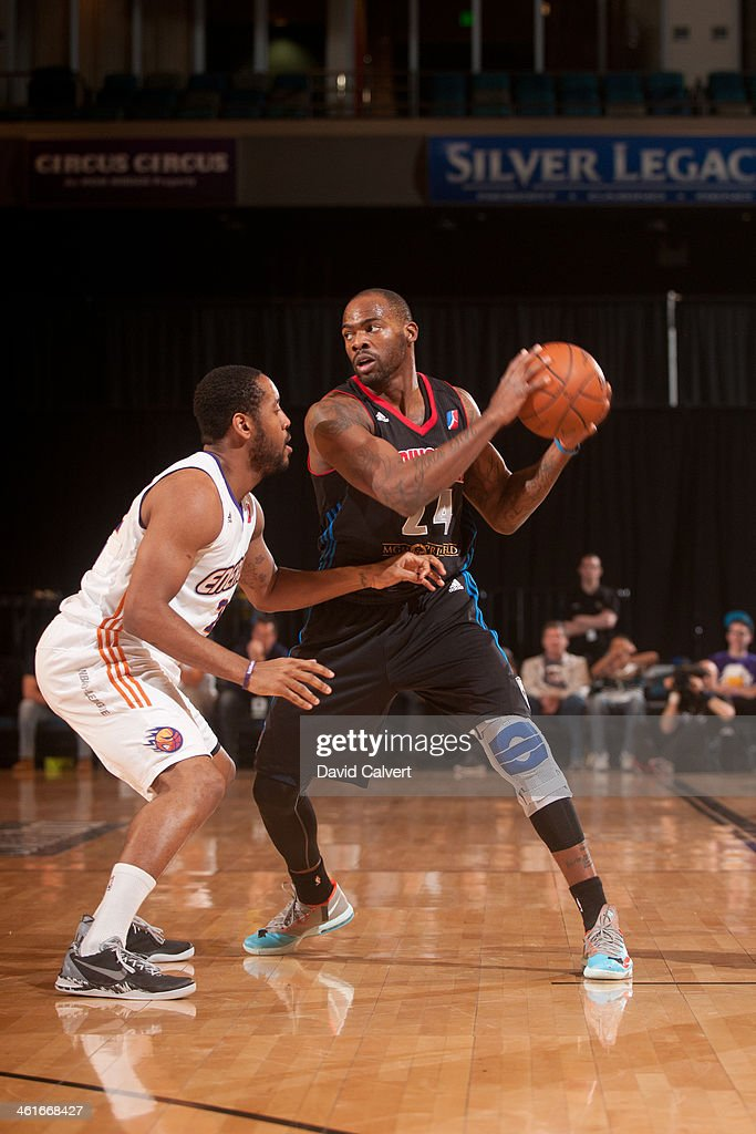Larry Anderson of the Springfield Armor guarded by Austin Freeman of the Iowa Energy during the 2014 NBA DLeague Showcase on January 9 2014 at the...