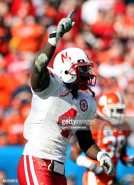 Larry Asante of the Nebraska Cornhuskers celebrates a recovered turnover during the Konica Minolta Gator Bowl against the Clemson Tigers at...