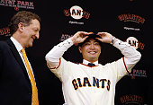 Larry Baer President and CEO of the San Francisco Giants introduces Norichika Aoki during a press conference at ATT Park on January 20 2015 in San...
