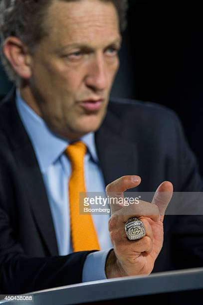 Larry Baer president and chief executive officer of the San Francisco Giants wears a World Series ring while speaking during a Bloomberg West...