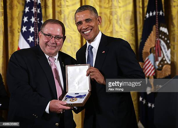 Larry Berra son of baseball legend Yogi Berra receives the Presidential Medal of Freedom on behalf of his father from US President Barack Obama...