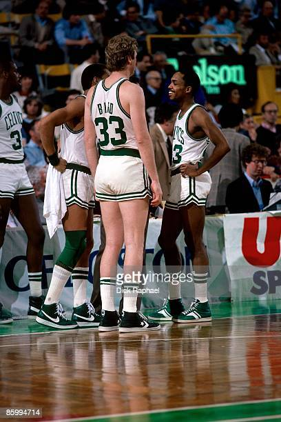 Larry Bird and Gerald Henderson of the Boston Celtics stand on the sideline during a time out during a game played in 1983 at the Boston Garden in...