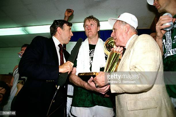 Larry Bird and head coach Red Auerbach of the Boston Celtics receive the Championship Trophy after defeating the Houston Rockets in the 1986 NBA...