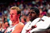 Larry Bird and Magic Johnson of the USA Men's Basketball team sit on the bench during the game at the Rose Garden in 1992 in Portland Oregon NOTE TO...