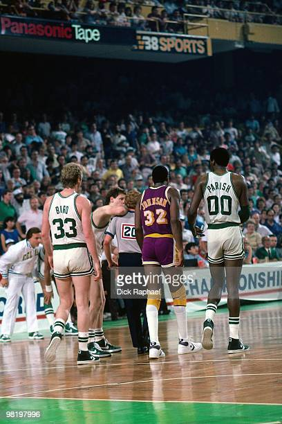 Larry Bird and Robert Parish of the Boston Celtics walk with Magic Johnson of the Los Angeles Lakers during the 1985 NBA Finals at the Boston Garden...