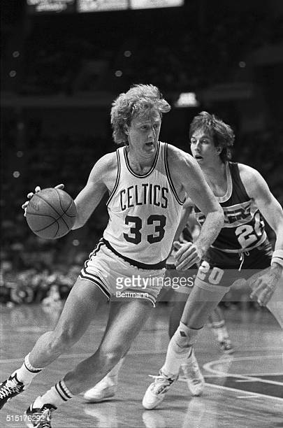 Larry Bird drives the lane on Pacers' forward Bill Garnett in early action 2/23 in Hartford