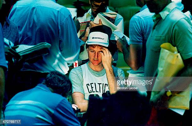 Larry Bird is surrounded by reporters before practice during Celtics NBA Finals against the Los Angeles Lakers in California on June 2 1987