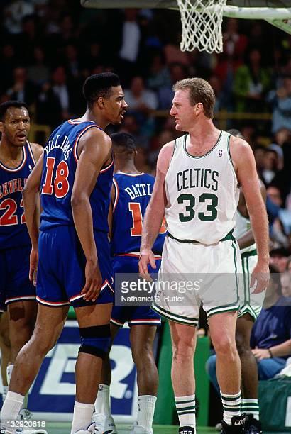 Larry Bird of the Boston Celtics and John 'Hot Rod' Williams talk during the 1991 NBA Playoffs at the Boston Garden in Boston Massachusetts circa...
