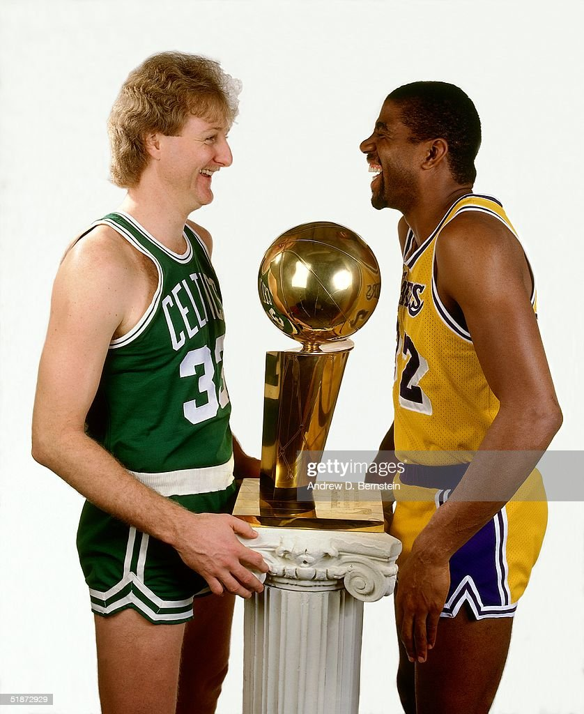 Larry Bird #33 of the Boston Celtics and Magic Johnson #32 of Los Angeles Lakers pose for a portrait with the NBA Champioinship Trophy in Los Angeles, California.
