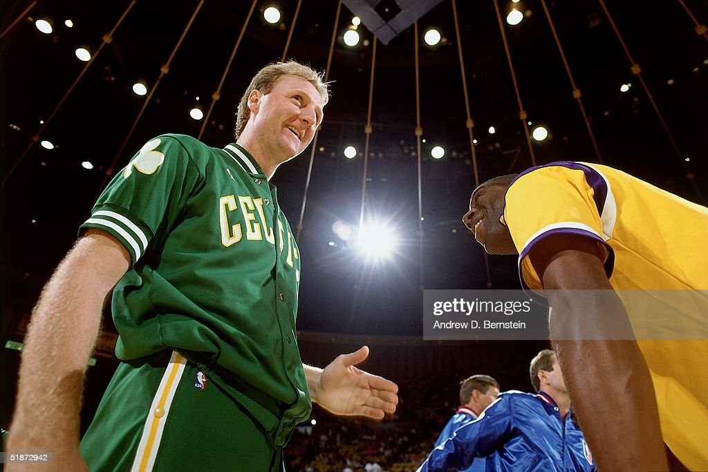 Larry Bird #33 of the Boston Celtics and Magic Johnson #32 of the Los Angeles Lakers meet at center court during the NBA game at the Forum in Los Angeles, California.