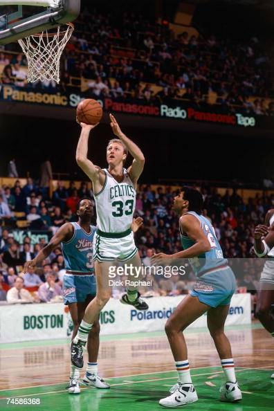 Larry Bird of the Boston Celtics attempts a shot against the Sacramento Kings during a 1980s NBA game at the Boston Garden in Boston Massachusetts...