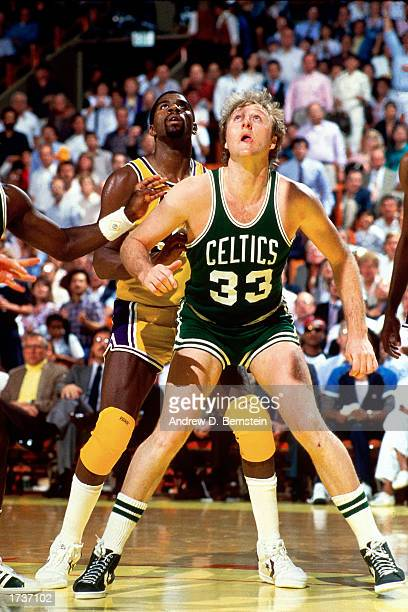 Larry Bird of the Boston Celtics battles for a rebound against Magic Johnson of the Los Angeles Lakers at The Great Western Forum on January 1 1984...
